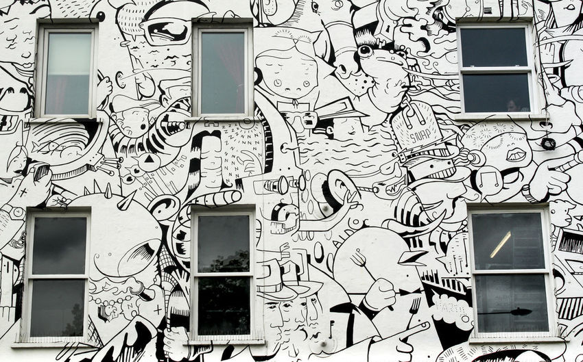 Low angle view of graffiti on wall of building