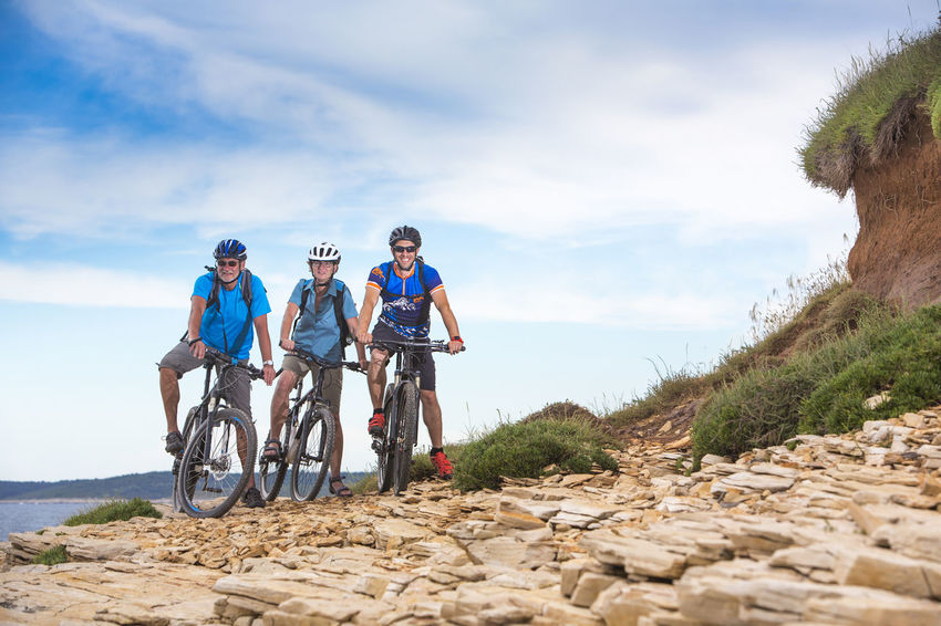 Senior couple on biketour with young bikeguide Activity Adriatic Sea Bicycle Bicycle Trip Bike Bikeguide Biketour Coastline Couple Cycling E-bike Ebike Guide Guiding Holiday Istria Leisure Activity Mountainbike Outdoors People Sea Senior Sports Summer Trip