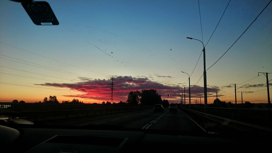 Road Sunset Dusk Sky Traffic Travel Cloud - Sky Outdoors No People Day Motion Driving Dramatic Latvia EyeEmNewHere Beauty In Nature Cityscape Cotton Candy Sky Car Sunrise Sun Summer Contrast Colors Horizon