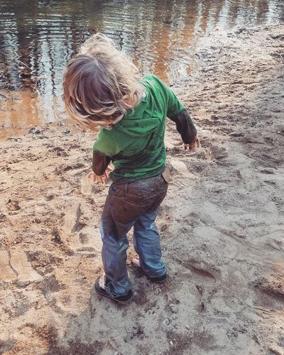 Sand Childhood Full Length Boys One Person Day Beach Outdoors Casual Clothing Real People Standing One Boy Only Water Nature Sand Pail And Shovel People Child Kid Model Happiness Life Events Nature Tree Sunlight Leisure Activity