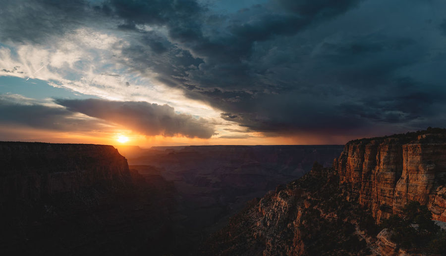 Sunset shot of the Grand Canyon National Park from the south rim with rain and storm clouds passing by. Capture Tomorrow Landscape No People Sunset Scenics - Nature Grand Canyon Grand Canyon National Park Storm Storm Cloud Rain Rain Clouds Sunlight Cliff Rim High Resolution Hiking Adventures Travel Destinations Clouds And Sky Golden Light Iconic Landmark Light And Shadow Light And Darkness  Nikonphotography Twilight Moody Sky