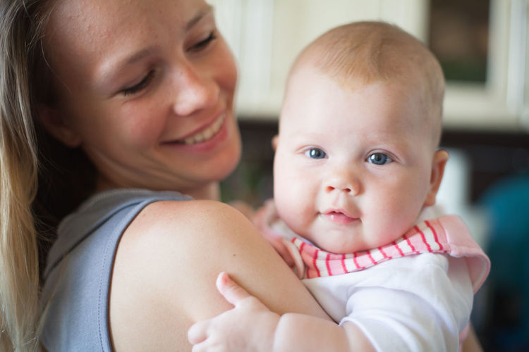 Close-up of mother with baby at home