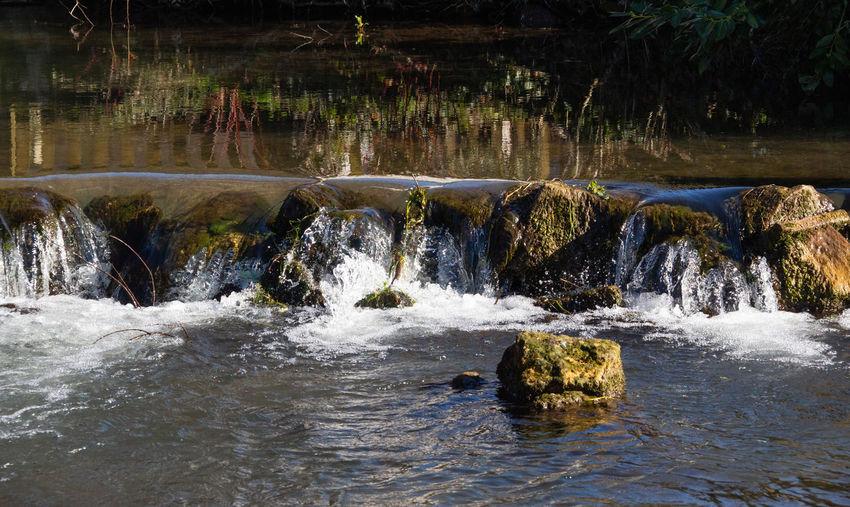 Bird Birdland Water Motion Beauty In Nature Flowing Water No People Rock River Flowing Outdoors Falling Water Stream - Flowing Water Rock - Object Day