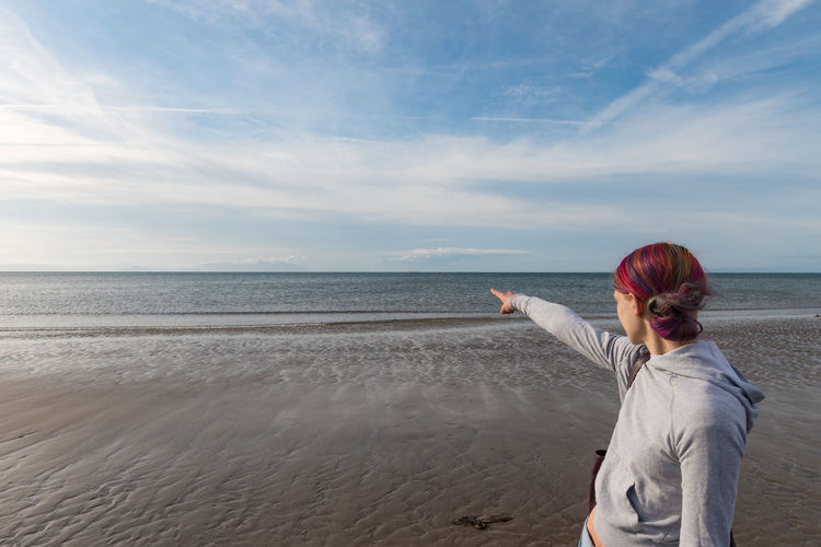 pointing out to sea Sea Water One Person Sky Beach Rear View Land Adult Cloud - Sky Horizon Hairstyle Redhead Scenics - Nature Nature Horizon Over Water Women Leisure Activity Casual Clothing Hair Looking At View Outdoors Dyed Red Hair