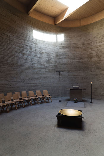Empty chairs by altar in chapel