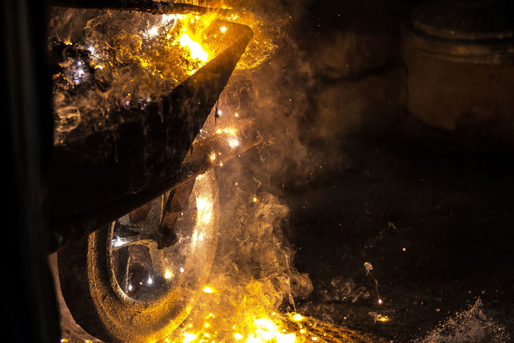 Steel and magnesium industry. Burning Hot Melting Wheel Bonfire Burn Burning Chariot Dont Touch Fire Fire - Natural Phenomenon Flame Glow Glowing Ground Heat Heat - Temperature Illuminated Job Lava Motion No People Orange Color Photography Yellow