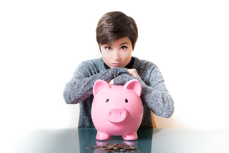 Thinking about savings on a piggy bank Bank Brunette Cash Coins Economic Financial Isolated Looking At Camera Money Moneybox One Person People Piggy Bank Pink Pretty Savings Thoughtful Woman Young