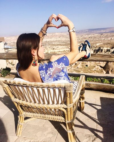 Cappadocia Girl Heart Hands In My Hand Leisure Activity Lifestyles Long Hair Outdoors Sitting Outside Sunlight Tourism Vacations Young Women In The Mood For Love Love Fashion