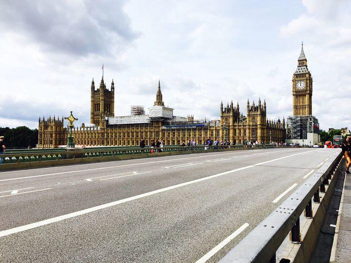 Westminster bridge leading towards big ben in city