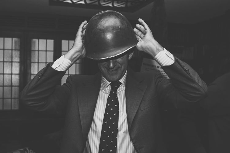 Old captain One Person Front View Men Business Males  Real People Adult Clothing Well-dressed Suit Waist Up Hat Holding Indoors  Standing Portrait Occupation Formalwear Leisure Activity Menswear Obscured Face