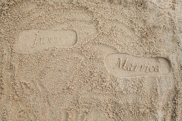 Footprints FootprintsInTheSand Just Married Love Wedding Backgrounds Beach Communication Creativity Elopement Eloping To Get Married Footprints In The Sand Just Married! Justmarried Justmarried💑 Marriage  Message Nature No People Outdoors Sand Text Textured  Wedding In Paradise Western Script #FREIHEITBERLIN