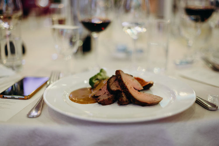 Roast as a main course for wedding dinner and reception. Photos taken during a wedding in Copenhagen, Denmark. Food Preparing Food Wedding Reception Food And Drink Freshness Raw Ingredients Real Wedding Healthy Eating Restaurant Catering Catering Service Catering Food Beef Roasted Roast Dinner Plate Table Indoors  Ready-to-eat Glass Business Close-up Still Life No People Setting Dinner Temptation