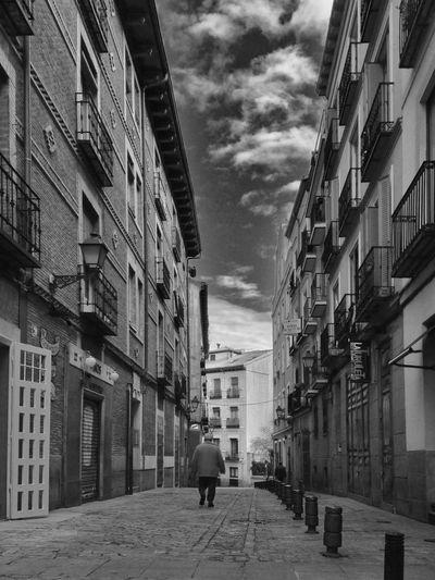 Narrow street leading towards buildings