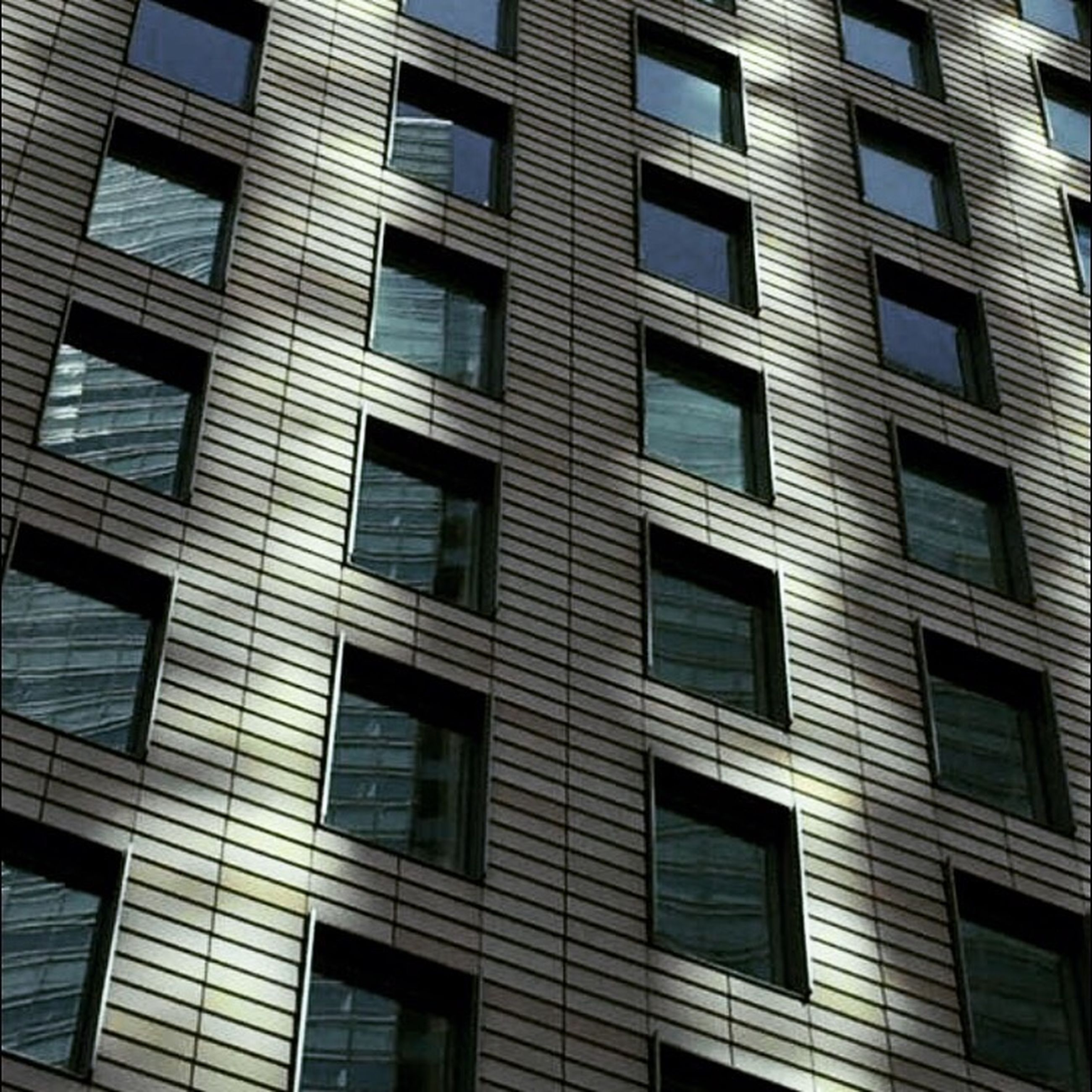 architecture, building exterior, built structure, window, full frame, low angle view, building, residential building, backgrounds, residential structure, apartment, city, balcony, repetition, day, in a row, glass - material, no people, outdoors, facade