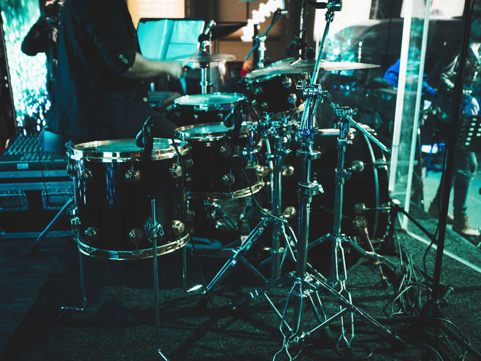 Midsection of man by drums