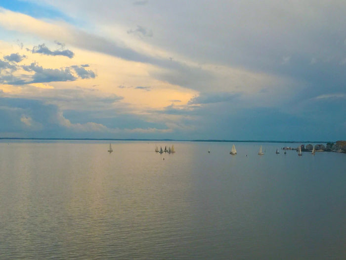 Sunset and boats. by Kesi J. Marcus Beauty In Nature Cloud - Sky Day Horizon Over Water Nature No People Outdoors Scenics Sea Sky Sunset Tranquil Scene Tranquility Water Waterfront The Traveler - 2018 EyeEm Awards