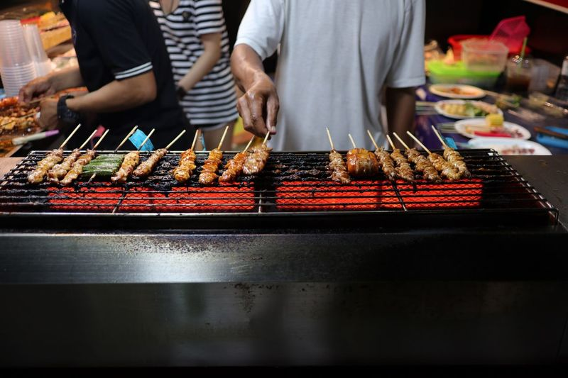 Streetfood Midsection Real People Food And Drink Men Food Preparation  Barbecue