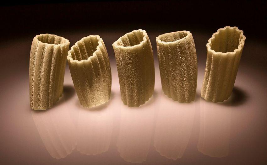 Close-Up Of Pasta Against Black Background