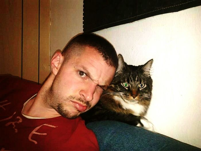 Nameth and his human Older Pet Caring Young Man Relationship Homies Devil On My Shoulder Love Me Or Leave Me Mental Telepathy Two Are One Handsome Young Man Facial Expression Feline Beard Pet Owner At Home Animal Face Loyalty Green Eyes