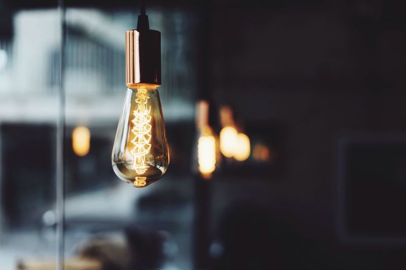 Close-up of glowing electric bulb