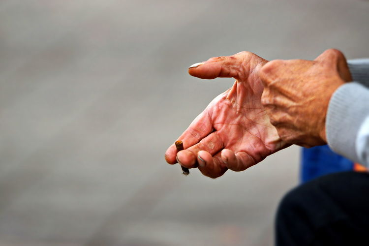 Close-up of hand against blurred background