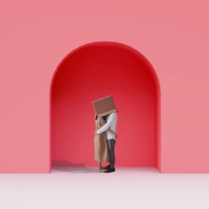 MAN HOLDING RED UMBRELLA