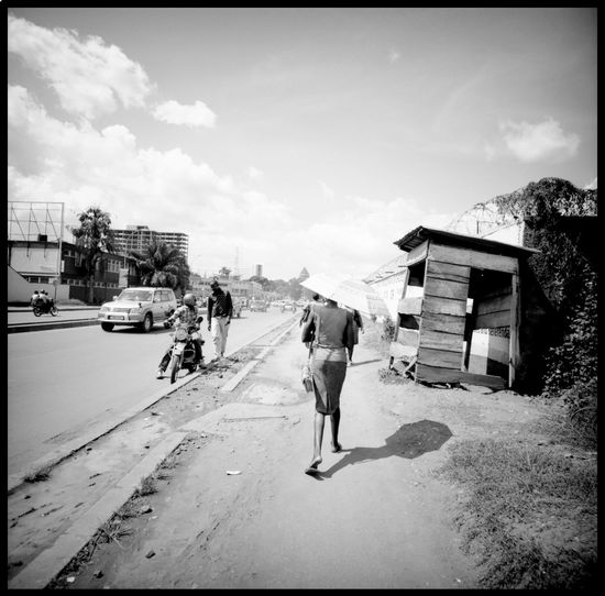 In the streets of Kampala 120 Mm Analogue Photography Architecture Cityscape Election Uganda Goats Lomography Motorcycle Rails Streets Of Kampala Travel Uganda  Umbrella In Africa Adventure Black And White East Africa Election Campaign Girl With Umbrella Kampala Kampala,uganda Marabu Medium Format People Urban