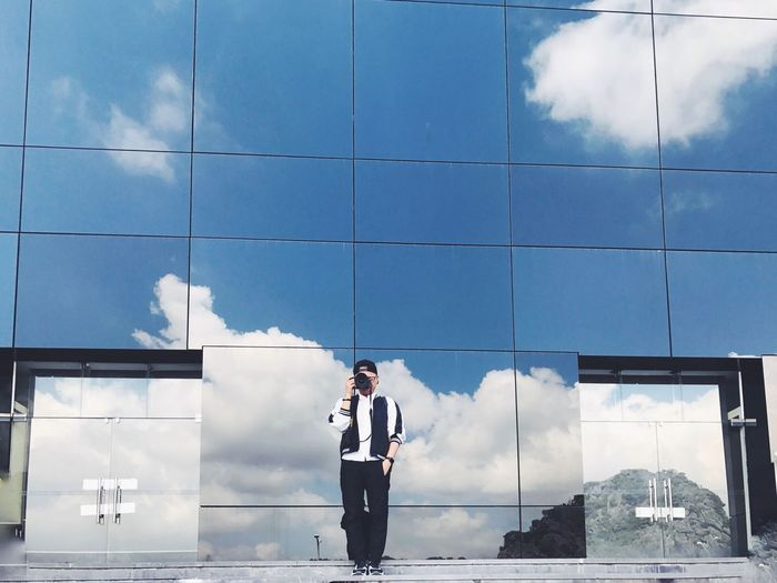 The cloud shooter - Cloud - Sky Sky Architecture One Person Standing Men Building Exterior Business Built Structure Day Technology Young Adult Outdoors One Man Only Only Men Adults Only Adult Photographer Portrait Symmetry Art EyeEm Best Shots My Year My View Museum Self Portrait