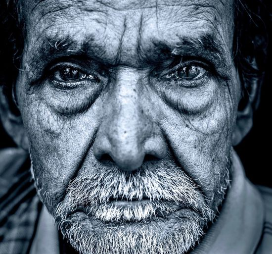 3rd world wrath Fine Art Photography Angry Man One Person Looking At Camera Portrait Close-up Headshot Adult Men Real People Human Face Human Body Part Body Part Mature Adult Black Background