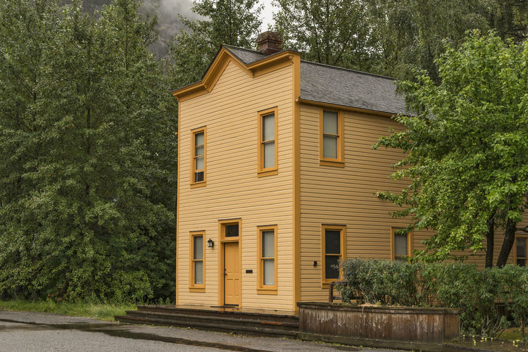 Architecture Building Exterior Tree Built Structure Building Residential District House Window No People Day Outdoors Entrance Wood - Material Door Alaska Orange Color Windows