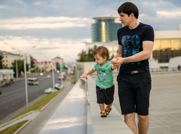 Bonding Boys Care Casual Clothing Child Childhood Day Family Family With One Child Full Length Innocence Leisure Activity Males  Men Outdoors Parent Real People Sky Son Togetherness