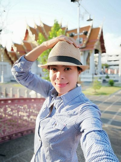 Travelphotography Hobby Happy People Smiling EyeEm Selects Bangkok Thailand. Photographerlife Tourism Temple Architecture Sunlight Portrait Looking At Camera Headwear Close-up Sky Flat Cap Gap Toothed Shining Posing