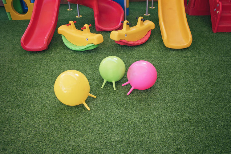 High angle view of colorful play equipment on turf