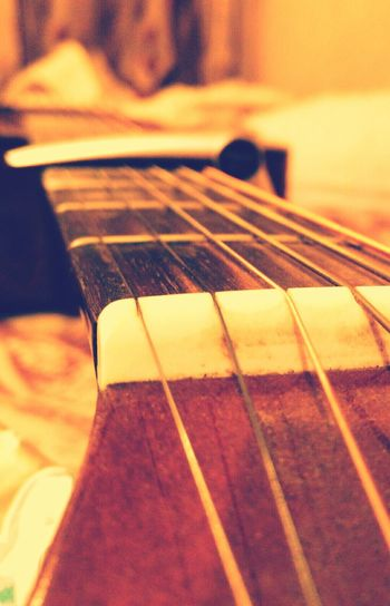 Sometimes the best thing to do with a guitar is to just look at it.. Oh, and click a pic of it. 😉 First Eyeem Photo Guitar Guitarlove Macro Strings Music Bright Colors Warmth Music On World Off