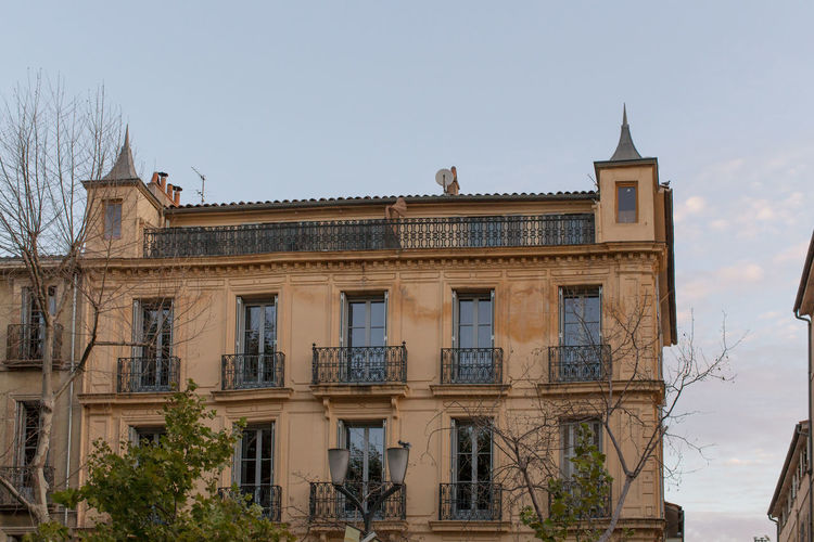 High section of building at Cours Mirabeau, Aix-en-Provence Arch Architecture Building Exterior Built Structure Clear Sky Day Exterior Façade High Section Historic History Low Angle View No People Outdoors Sky Stone Material Window
