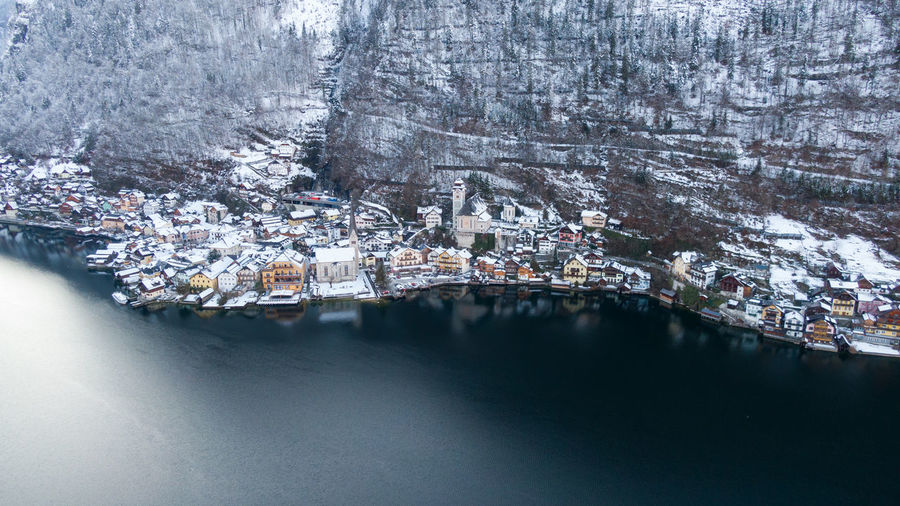High angle view of buildings by city during winter