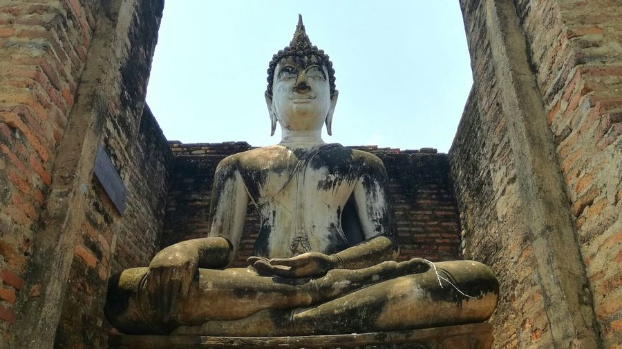Buddha Religion Place Of Worship Statue Spirituality Human Representation Cultures Old Ruin Large History Low Angle View Human Body Part Idol Outdoors Day Human Hand Sky Ancient Civilization People Sukothai Thailand