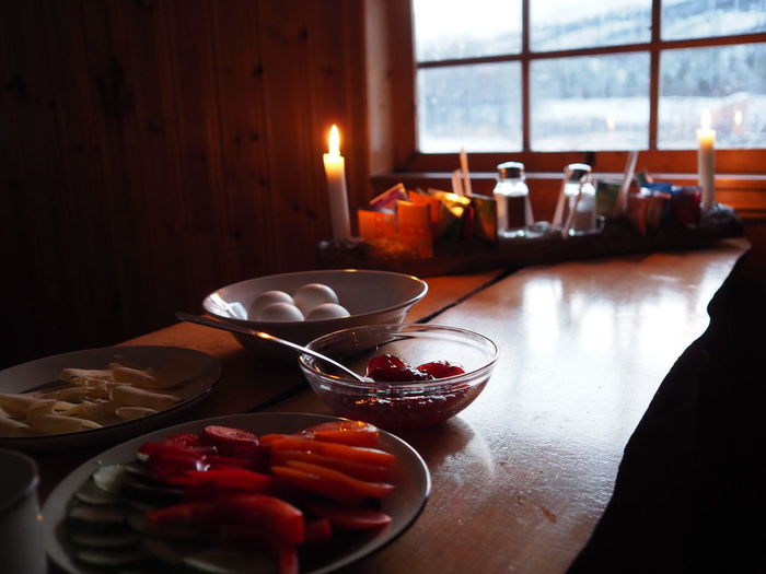 Close-up of breakfast on table against window