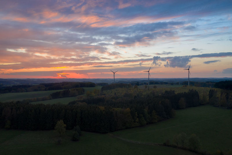 Sky Cloud - Sky Sunset Turbine Wind Turbine Renewable Energy Landscape Alternative Energy Scenics - Nature Wind Power Beauty In Nature Tranquil Scene Tranquility Field Nature Plant Land No People Outdoors Sustainable Resources Power Supply Drone  Dronephotography Drone Photography