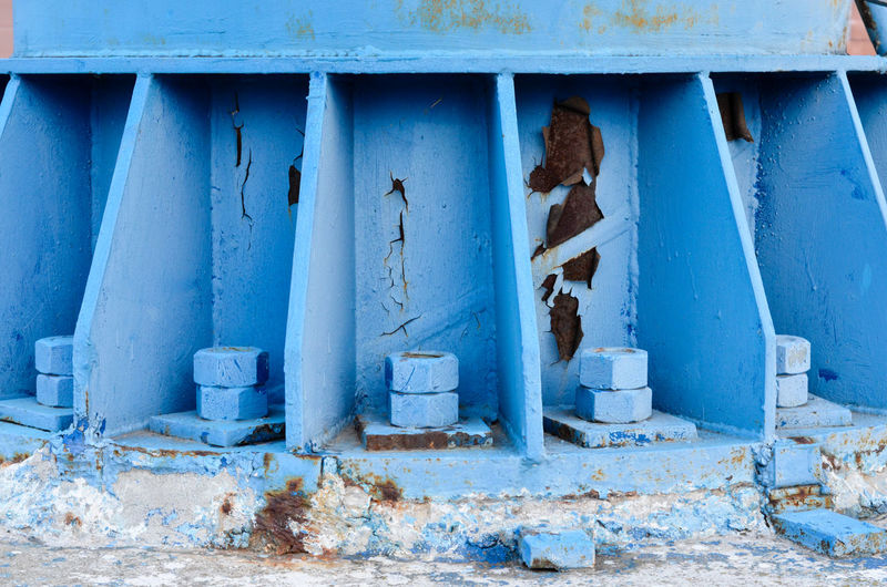 Close up of blue bolts and nuts used for hold the base structure of steel pole . Bolt Metal Nut Steel Screw Industry Construction Tool Equipment Industrial Iron Hardware Metallic Mechanic Repair Closeup Macro Engineering Stainless Part Nuts Technology Old Mechanical Thread Fix  Detail HEAD Group Build Close Chrome Rusty Connection Accessory Technical Component Grunge Stainless Steel  Color Construction Industry Dirty Blue Outdoors Architecture Concrete Built Structure No People Day Weathered Ruined
