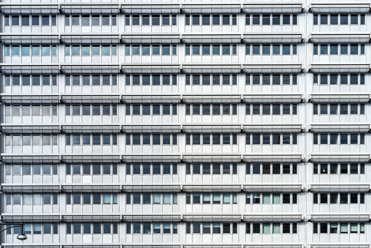 Symmetry Windows Office Building Pattern Building Exterior Architecture Built Structure Backgrounds Full Frame Window Repetition Building Day No People In A Row City Residential District Low Angle View Apartment Outdoors Side By Side Modern Nature