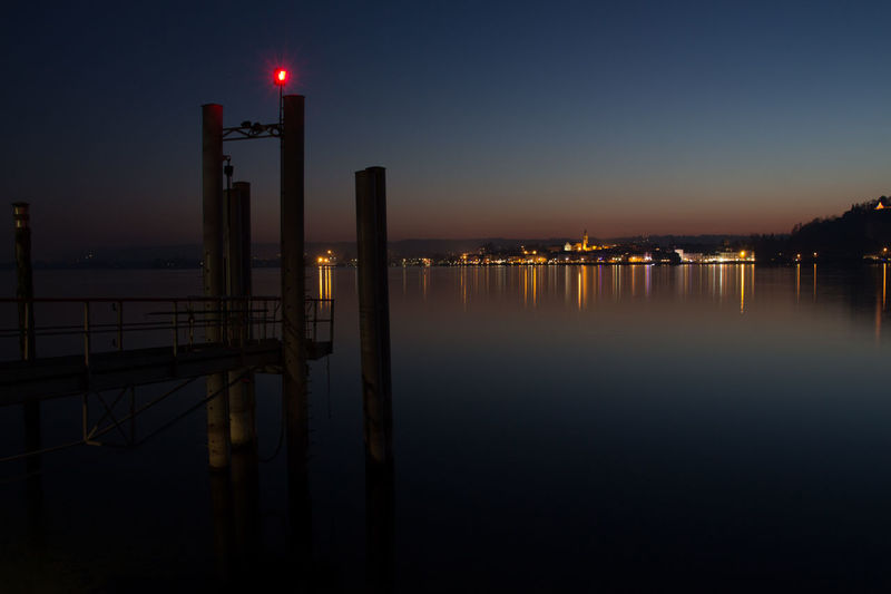 View of illuminated pier at night
