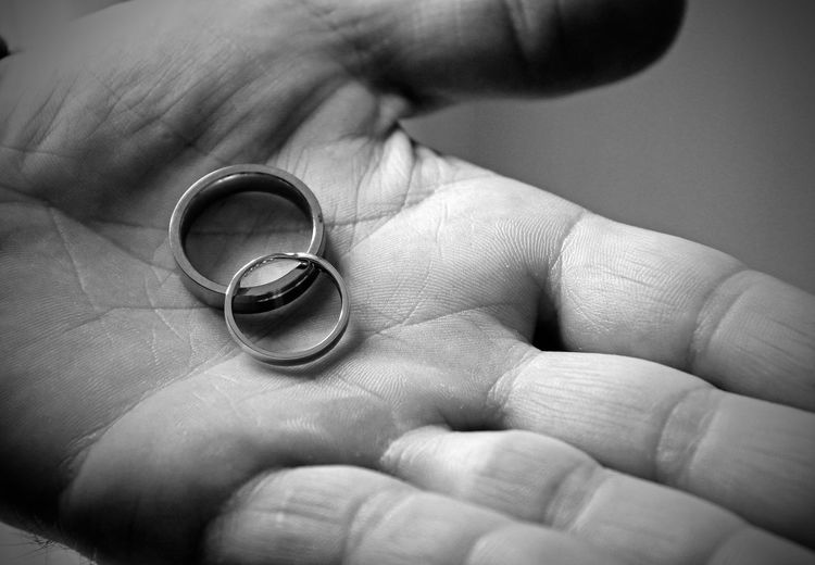 Adult Adults Only Black And White Bride Close-up Day Groom Holding Human Body Part Human Finger Human Hand Husband Indoors  Jewelry Life Events Love Marriage  Married Men People Ring Togetherness Wedding Wedding Wedding Ring