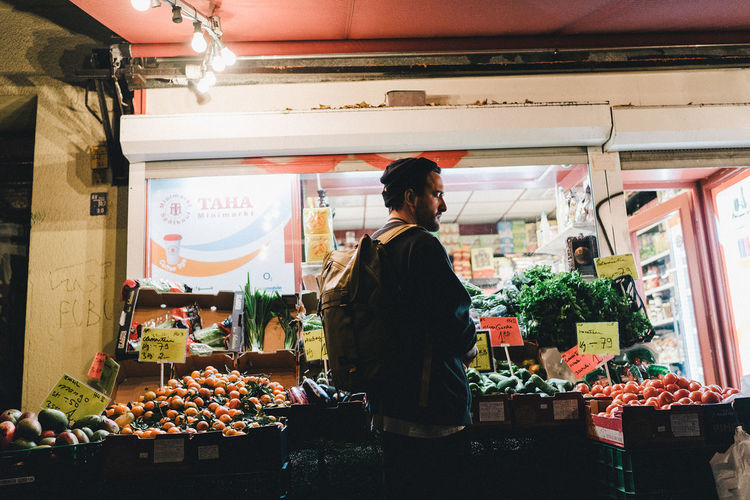 Woman standing in market stall