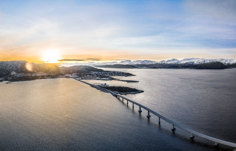 Amazing sunset inr Norway with long bridge. Amazing View City Norway Road Scandinavia Amazing Beauty In Nature Bridge Bridge - Man Made Structure Environment Evening Fjord Infrastructure Mountain Nature Northeurope Scenics - Nature Sky Snow Snowcapped Mountain Structure Sunset Sunset #sun #clouds #skylovers #sky #nature #beautifulinnature #naturalbeauty #photography #landscape Winter Ålesund, Norway