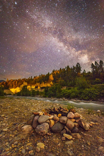 Count the stars by the campfire | Would you like to stay up a little bit and count the stars by the campfire? Roll out your blanket. Make yourself comfortable. Let me boil some water for your hot cocoa. Let the crickets chirp and the frogs sing while watching the Milky Way move across the sky above us. Kootenay River, British Columbia, Canada Adventure Astrophotography Beauty In Nature British Columbia Campsite Canada Firepit Galaxy Kootenay Riv Landscape Photography Nature Night Night Photography Non-urban Scene Outdoors PNW River Road Trip Rocks Sky Stars The Milky Way Tranquility Travel Trees