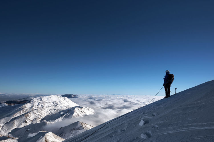 Man standing on snowcapped cervino mountain against clear sky