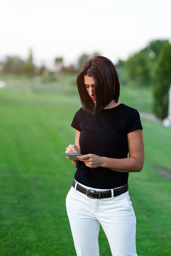 Woman playing with ball on grass