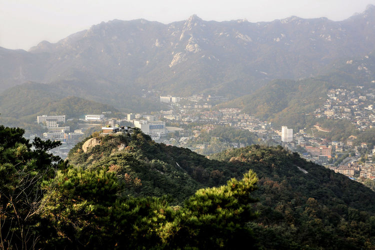 Beauty In Nature Bukhansan Community Day Exploring Geology Green High Angle View Hill Human Settlement Inwang Mountain Landscape Lush Foliage Mountain Mountain Range Outdoors Physical Geography Rock Scenics Stream Top Perspective Tranquil Scene Valley