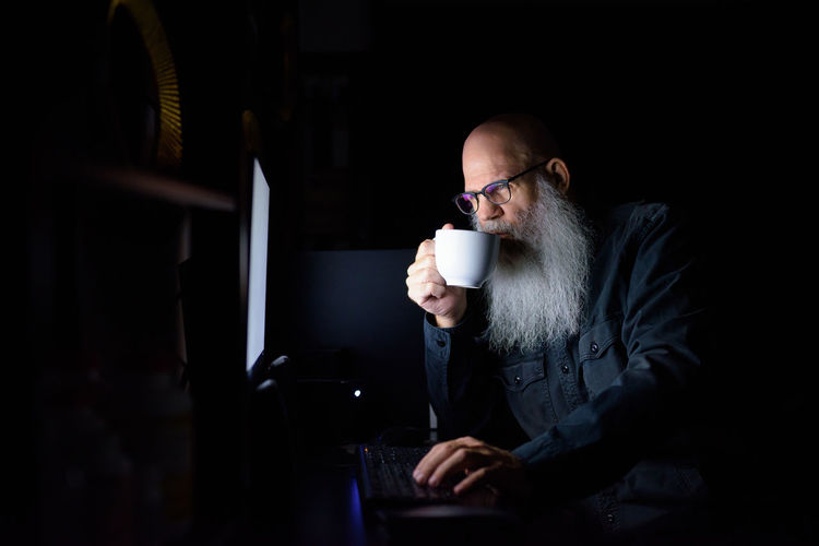 Man drinking coffee while sitting at home